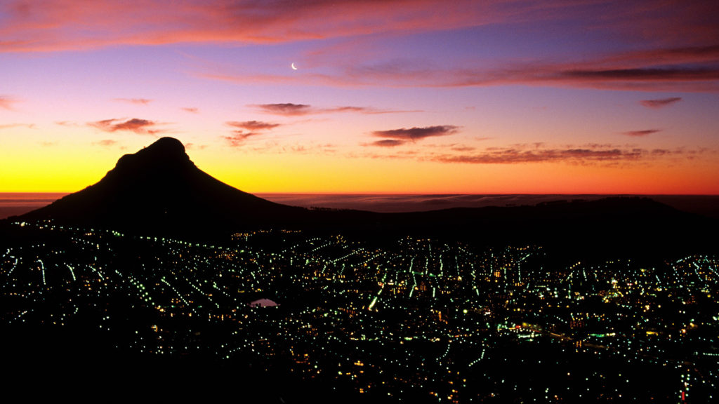 Cape Town, South Africa --- Lion's Head Mountain and Cape Town at Night --- Image by © Bertrand Rieger/Hemis/Corbis